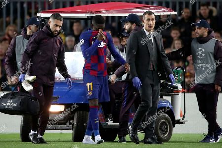 Barcelona's Ousmane Dembele leaves the field after getting injured during a Champions League group F soccer match between Barcelona and Borussia Dortmund at the Camp Nou stadium in Barcelona, Spain