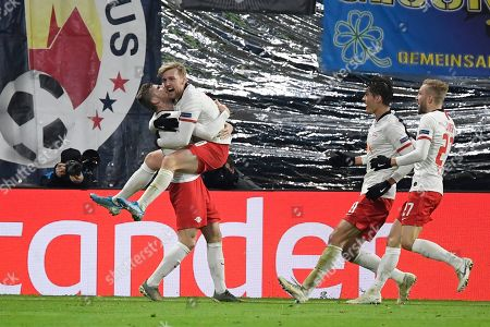 Stock Photo of Leipzig's Emil Forsberg, second from left, celebrates with teammates after scoring his side's second goal during the Champions League group G soccer match between RB Leipzig and Benfica in Leipzig, Germany