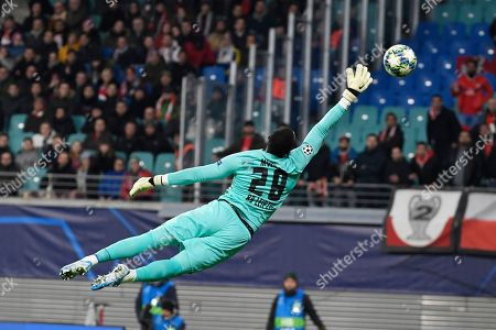 Leipzig's goalkeeper Yvon Mvogo jumps for the ball during the Champions League group G soccer match between RB Leipzig and Benfica in Leipzig, Germany