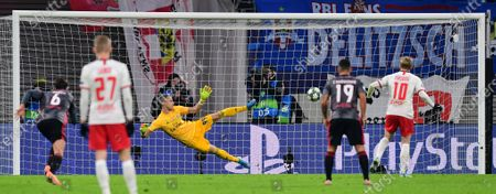 Stock Picture of Emil Forsberg of Leipzig (R) scores the 1-2 goal by penalty during the UEFA Champions League group G soccer match between RB Leipzig vs Benfica Lisbon in Leipzig, Germany 27 November 2019.