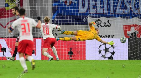 Stock Image of Emil Forsberg of Leipzig (2-R) scores the 2-2 equalizer during the UEFA Champions League group G soccer match between RB Leipzig vs Benfica Lisbon in Leipzig, Germany 27 November 2019.