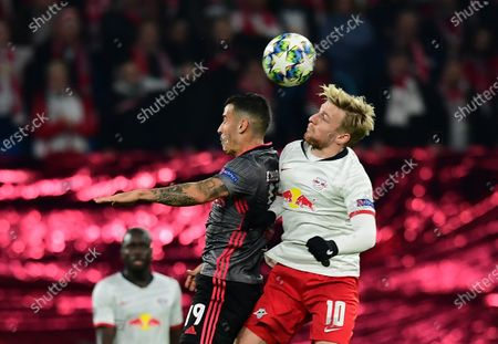 Emil Forsberg of Leipzig (R) in action against Chiquinho of Benfica (L) during the UEFA Champions League group G soccer match between RB Leipzig vs Benfica Lisbon in Leipzig, Germany 27 November 2019.