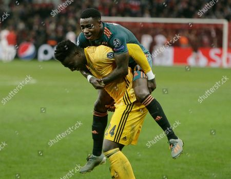 Stock Picture of Ajax's goalkeeper Andre Onana, left, and Ajax's Quincy Promes celebrate at the end of the Champions League, group H, soccer match between Lille and Ajax at Stade Pierre Mauroy - Villeneuve d'Ascq stadium in Lille, France, . Ajax won 2-0