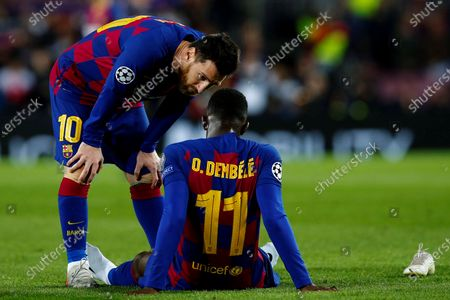 FC Barcelona's Ousmane Dembele (R) talks to teammate Lionel Messi (L) after being injured during a UEFA Champions League's group F soccer match between FC Barcelona and Borussia Dortmund at the Camp Nou Stadium in Barcelona, Spain, 27 November 2019.