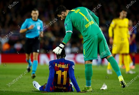 FC Barcelona's Ousmane Dembele (C) reacts with Borussia Dortmund's goalkeeper Roman Buerki (R) after being injured during a UEFA Champions League's group F soccer match between FC Barcelona and Borussia Dortmund at the Camp Nou Stadium in Barcelona, Spain, 27 November 2019.