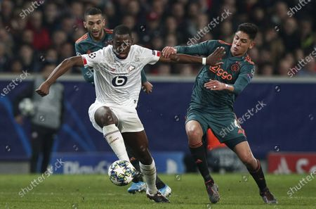 Lille's Boubakary Soumare (L) and Edson Alvarez of Ajax (R) in action during the UEFA Champions League Group H soccer match between Lille LOSC and Ajax Amsterdam at Pierre Mauroy stadium in Villeneuve-d'Ascq, France, 27 November 2019.