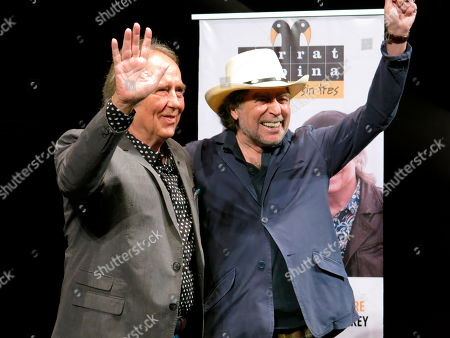"Spanish songwriters and musicians Joan Manuel Serrat, left, and Joaquin Sabina, wave as they pose for photos during a press conference promoting their tour: ""No hay dos sin tres,"" in Mexico City"