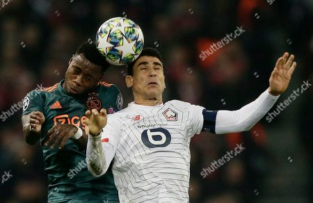 Ajax's Quincy Promes, left, and Lille's Benjamin Andre head he ball during the group H Champions League soccer match between LOSC Lille and Ajax at the Stade Pierre Mauroy - Villeneuve d'Ascq stadium in Lille, France