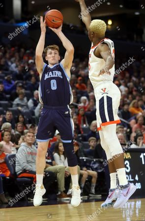 Maine forward Andrew Fleming (0) shoots over Virginia forward Mamadi Diakite (25) during an NCAA college basketball game in Charlottesville, Va