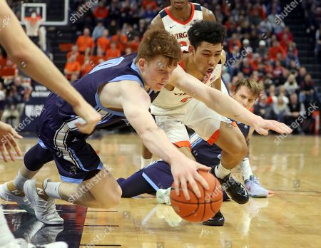 Maine forward Andrew Fleming (0) goes after a loose ball with Virginia guard Kihei Clark (0) during an NCAA college basketball game in Charlottesville, Va., . Virginia won 46-26