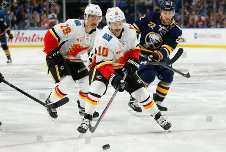 Calgary Flames forward Derek Ryan (10) carries the puck during the first period of an NHL hockey game against the Buffalo Sabres, in Buffalo, N.Y