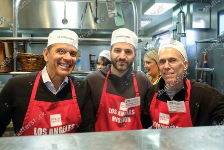 Former Los Angeles mayor Antonio Villaraigosa (L), producer David Katzenberg (C), and CEO of Dreamworks, Jeffrey Katzenberg, serve Thanksgiving meal at the Los Angeles Mission, in Los Angeles, California, USA, 27 November 2019. Thousands of Skid Row residents and homeless people from downtown and beyond were served Thanksgiving dinners during the Los Angeles Mission's annual holiday feast.