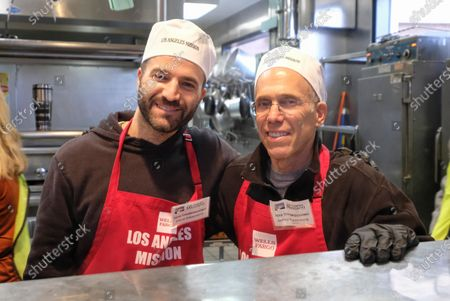 Producer David Katzenberg (L), and CEO of Dreamworks, Jeffrey Katzenberg, serve Thanksgiving meal at the Los Angeles Mission, in Los Angeles, California, USA, 27 November 2019. Thousands of Skid Row residents and homeless people from downtown and beyond were served Thanksgiving dinners during the Los Angeles Mission's annual holiday feast.