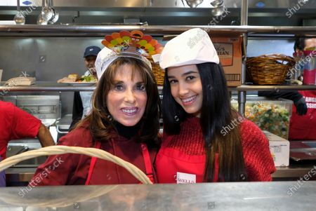 US actresses Kate Linder (L), and Emily Tosta serve Thanksgiving meal at the Los Angeles Mission, in Los Angeles, California, USA, 27 November 2019. Thousands of Skid Row residents and homeless people from downtown and beyond were served Thanksgiving dinners during the Los Angeles Mission's annual holiday feast.