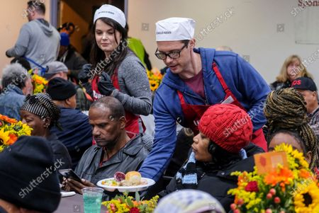 US actors Daniel Kountz (R), and Kimberly Brown (2-L), serve Thanksgiving meal at the Los Angeles Mission, in Los Angeles, California, USA, 27 November 2019. Thousands of Skid Row residents and homeless people from downtown and beyond were served Thanksgiving dinners during the Los Angeles Mission's annual holiday feast.
