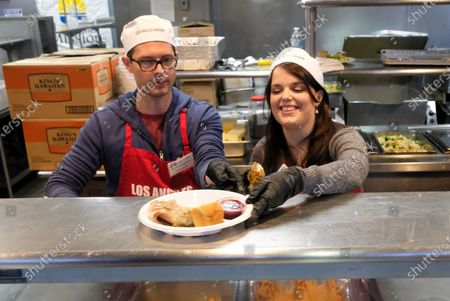 Stock Picture of US actors Daniel Kountz (L) and Kimberly Brown, serve Thanksgiving meal at the Los Angeles Mission, in Los Angeles, California, USA, 27 November 2019. Thousands of Skid Row residents and homeless people from downtown and beyond were served Thanksgiving dinners during the Los Angeles Mission's annual holiday feast.