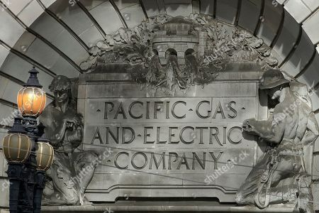 "Oct. 10, 2019, a Pacific Gas & Electric sign is shown outside of a PG&E building in San Francisco. A federal bankruptcy court judge, rejected Pacific Gas & Electric's latest attempt to change a California law requiring utilities to pay for the devastation from wildfires ignited by their electrical equipment. The decision issued by U.S. Bankruptcy Judge Dennis Montali preserves a long-standing principle known as ""inverse condemnation"