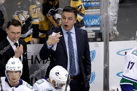 Vancouver Canucks head coach Travis Green asks for a review of a goal by Pittsburgh Penguins' Kris Letang during the third period of an NHL hockey game in Pittsburgh, . The goal was allowed and it proved to be the game-winner. The Penguins won 8-6