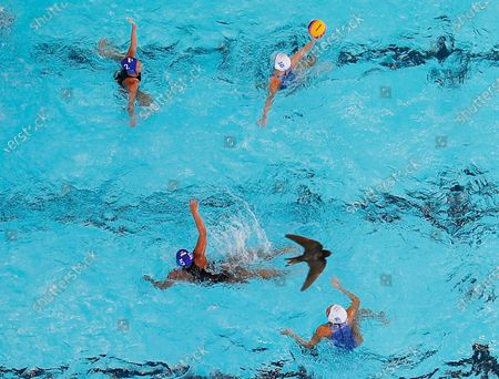 Issaree Turon (R, top) of Thailand in action during a SEA Games 2019 Water Polo Women's Double Round Robin match between Philippines and Thailand at the New Clark City Aquatics Center in Capas, Philippines, 28 November 2019. The SEA Games 2019 is expected to hold its opening ceremony on 30 November 2019.