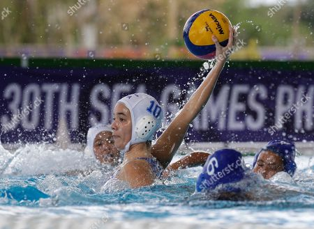 Thailand's Issaree Turon prepares to throw the ball to the goal during their 1st round robin water polo women's match against Philippines at the 30th South East Asian Games at the New Clark City, Tarlac province, northern Philippines on . Thailand won 32-5