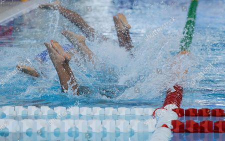 Thailand water polo players jump in the pool as they begin their 1st round robin women's match against Philippines at the 30th South East Asian Games at the New Clark City, Tarlac province, northern Philippines on . Thailand won 32-5
