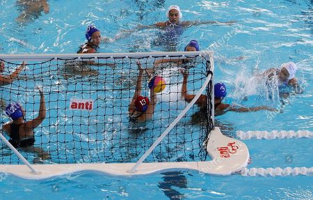 Thailand's Nirawan Chompoopuen, right, scores a goal during their 1st round robin water polo women's match against Philippines at the 30th South East Asian Games at the New Clark City, Tarlac province, northern Philippines on . Thailand won 32-5