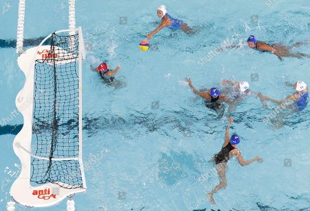 Thailand's Thitirat Souyos throws the ball to the goal during their 1st round robin water polo women's match against Philippines at the 30th South East Asian Games at the New Clark City, Tarlac province, northern Philippines on . Thailand won 32-5