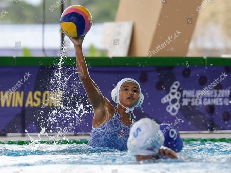 Thailand's Saeteaw Kaithip throws the ball during their 1st round robin water polo women's match against Philippines at the 30th South East Asian Games at the New Clark City, Tarlac province, northern Philippines on . Thailand won 32-5