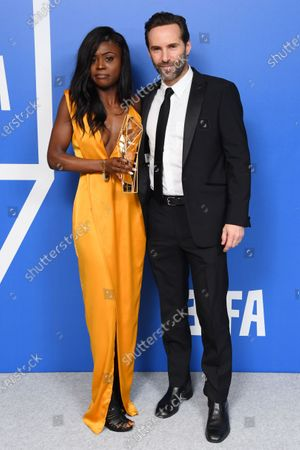 Ruthxjiah Bellenea - Best Supporting Actress - The Last Tree, holding the BIFA trophy, created by Swarovski, accompanied by Alessandro Nivola
