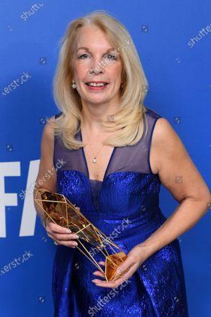 Amanda Neville - Special Jury Prize holding the BIFA trophy, created by SwarovskiAmanda Neville - Special Jury Prize
