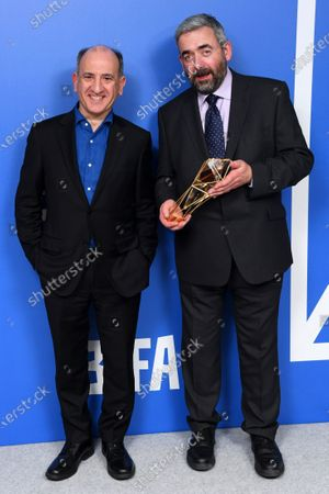 Armando Iannucci, Simon Blackwell - Best Screenplay - The Personal History Of David Copperfield, holding the BIFA trophy, created by Swarovski