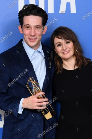 Josh O'Connor - Best Actor - Only You, holding the BIFA trophy, created by Swarovski, accompanied by Emily Mortimer