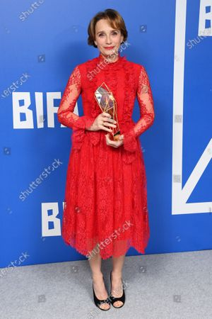 Kristin Scott Thomas - Richard Harris Award, holding the BIFA trophy, created by Swarovski