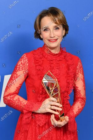 Kristin Scott Thomas - Richard Harris Award, holding the BIFA trophy, created by Swarovski