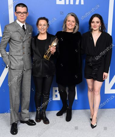Kate Byers, Linn Waite - Breakthrough Producer - Bait holding the BIFA trophy, created by Swarovski, accompanied by Asa Butterfield and Aisling Franciosi