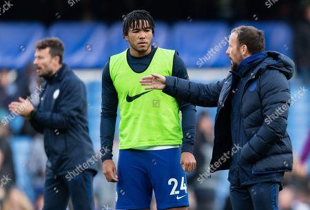 Reece James of Chelsea talks to Chelsea Coach Jody Morris