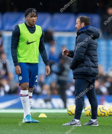 Reece James of Chelsea talks to coach Jody Morris