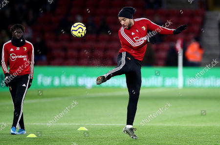 Troy Deeney of Watford warms up.