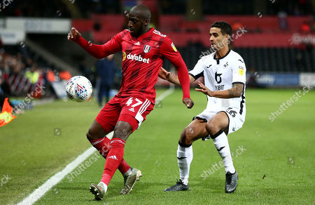 Aboubakar Kamara of Fulham and Kyle Naughton of Swansea City.