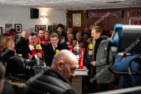 Dan Walker presents BBC Football Focus in the club bar