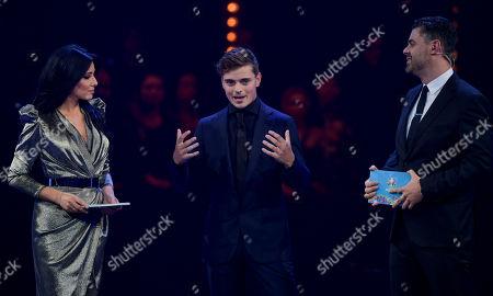 DJ Martin Garrix joins presenters Corina Caragea, and Pedro Pinto on stage