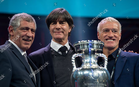 Fernando Santos, Head Coach of Portugal, Didier Deschamps, Head Coach of France, and Joachim Loew, Head Coach of Germany pose with the trophy