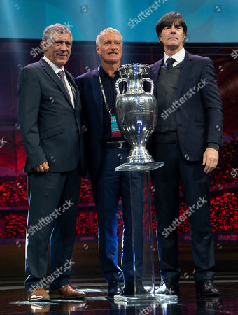 Stock Picture of Fernando Santos, Head Coach of Portugal, Didier Deschamps, Head Coach of France, and Joachim Loew, Head Coach of Germany pose with the trophy