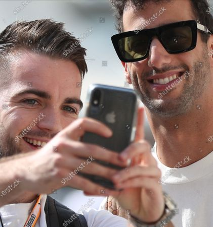 Australian Formula One driver Daniel Ricciardo (R) of Renault has a picture taken with a fan at the paddock of Yas Marina Circuit during Abu Dhabi Formula 1 Grand Prix 2019 in Abu Dhabi, United Arab Emirates, 28 November 2019. The Formula One Grand Prix of Abu Dhabi will take place on 01 December 2019.