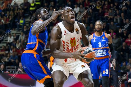 Michael Ojo of Crvena Zvezda mts Belgrade competes against Maurice Ndour of Valencia Basket
