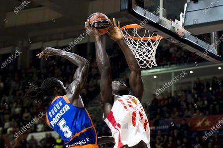 Maurice Ndour of Valencia Basket tries to block Michael Ojo of Crvena Zvezda mts Belgrade
