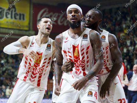 Lorenzo Brown of Crvena Zvezda mts Belgrade scores and celebrates the victory with Charles Jenkins of Crvena Zvezda mts Belgrade and Billy Baron of Crvena Zvezda mts Belgrade