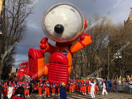 Stock Image of The Snoopy balloon is ready to go at the start of the Macy's Thanksgiving Day Parade, in New York