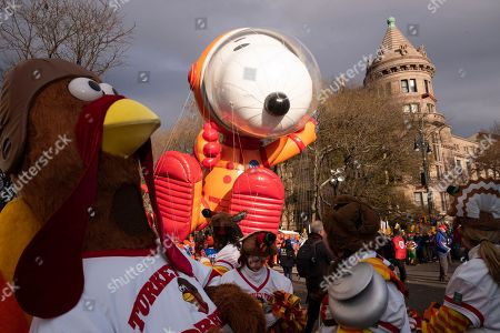 Stock Picture of Snoopy Astronaut balloon is aloft at the start of the Macy's Thanksgiving Day Parade, in New York