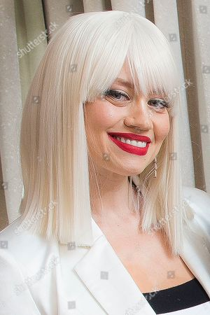 Stock Photo of Kimberley Wyatt, of the Pussycat Dolls, poses for portraits at a central London hotel, following an interview with the Associated Press - before they reunite for The X Factor: Celebrity final this weekend